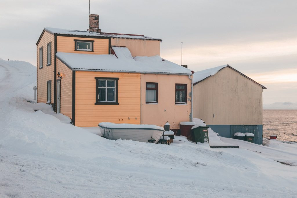 iceland on a budget house in the snow