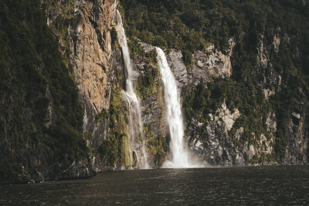 milford sound waterfall on a day trip from queenstown
